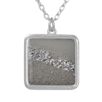 Seashells on sand Summer beach background Top view Silver Plated Necklace