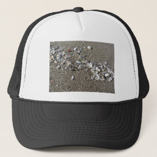 Seashells on sand. Summer beach background Trucker Hat