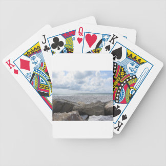Seashore of a beach in a cloudy day at summer bicycle playing cards