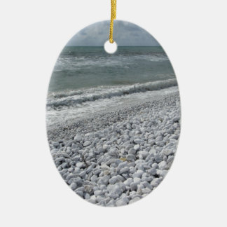 Seashore of a beach in a cloudy day at summer ceramic oval ornament
