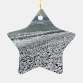 Seashore of a beach in a cloudy day at summer ceramic star ornament