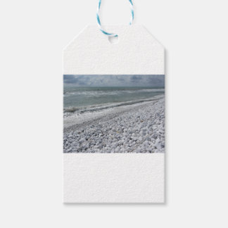 Seashore of a beach in a cloudy day at summer gift tags