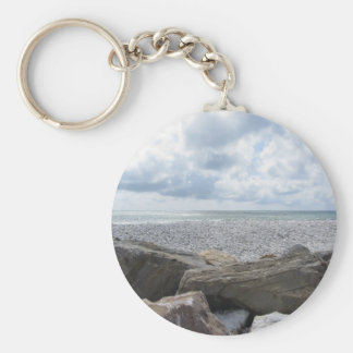 Seashore of a beach in a cloudy day at summer keychain