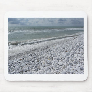Seashore of a beach in a cloudy day at summer mouse pad