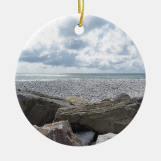 Seashore of a beach in a cloudy day at summer round ceramic ornament