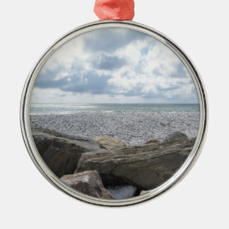 Seashore of a beach in a cloudy day at summer Silver-Colored round ornament