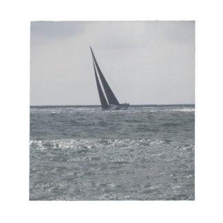 Seashore of beach during regatta notepads