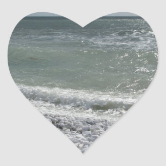 Seashore of beach in a cloudy day at summer heart sticker