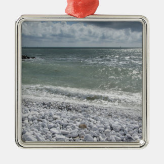 Seashore of beach in a cloudy day at summer metal ornament