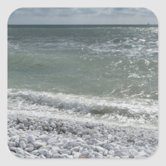 Seashore of beach in a cloudy day at summer square sticker