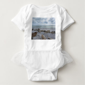 Seashore of beach with sailboats on the horizon baby bodysuit