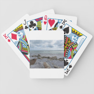 Seashore of beach with sailboats on the horizon bicycle playing cards