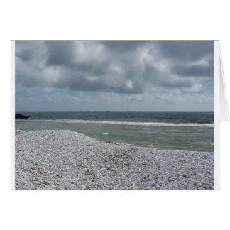 Seashore of beach with sailboats on the horizon card