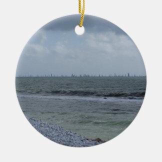 Seashore of beach with sailboats on the horizon ceramic ornament
