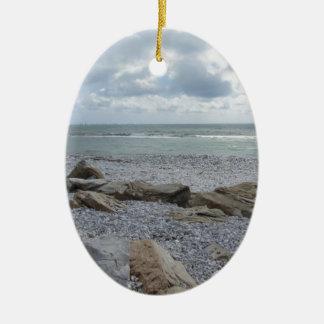 Seashore of beach with sailboats on the horizon ceramic oval ornament