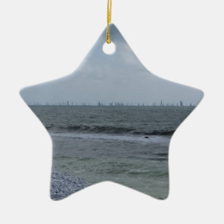 Seashore of beach with sailboats on the horizon ceramic star ornament