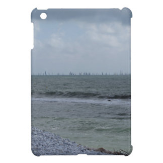 Seashore of beach with sailboats on the horizon cover for the iPad mini