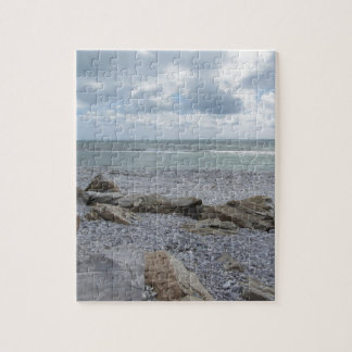 Seashore of beach with sailboats on the horizon jigsaw puzzle