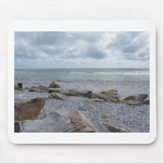 Seashore of beach with sailboats on the horizon mouse pad