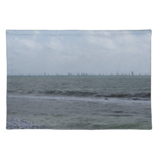 Seashore of beach with sailboats on the horizon placemat
