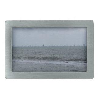 Seashore of beach with sailboats on the horizon rectangular belt buckles