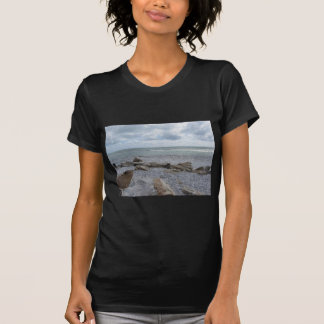 Seashore of beach with sailboats on the horizon T-Shirt
