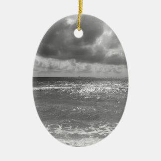 Seashore of Marina di Pisa beach in a cloudy day Ceramic Oval Ornament