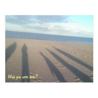 Seaside shadows on the sand postcard