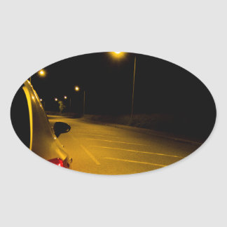 Seat Ibiza on the lonely road Oval Sticker