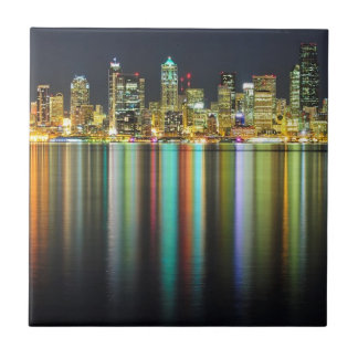 Seattle skyline at night with reflection tiles