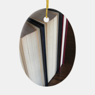 Second hand books standing on a wooden table ceramic ornament