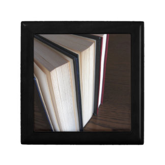 Second hand books standing on a wooden table gift box