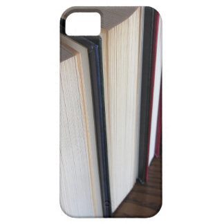 Second hand books standing on a wooden table iPhone 5 case
