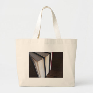 Second hand books standing on a wooden table large tote bag