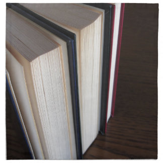 Second hand books standing on a wooden table napkin