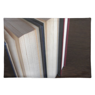 Second hand books standing on a wooden table placemat