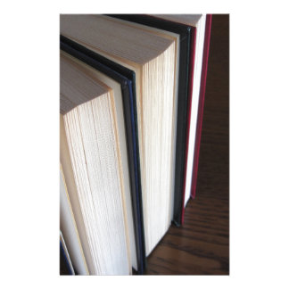 Second hand books standing on a wooden table stationery