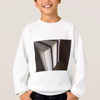 Second hand books standing on a wooden table sweatshirt