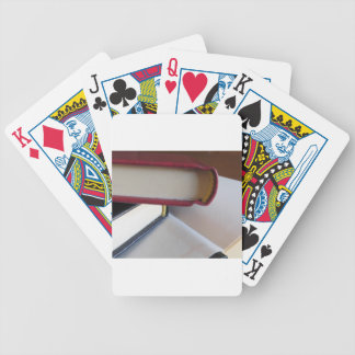 Second hand books with blank pages on a table bicycle playing cards
