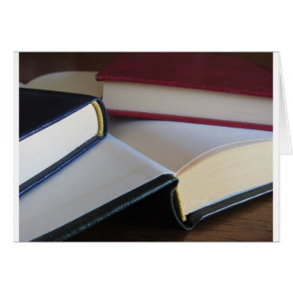 Second hand books with blank pages on a table card
