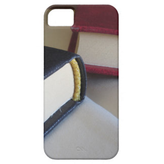 Second hand books with blank pages on a table case for the iPhone 5
