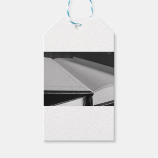 Second hand books with blank pages on a table gift tags