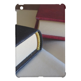 Second hand books with blank pages on a table iPad mini cover