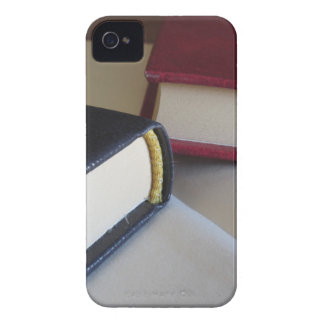 Second hand books with blank pages on a table iPhone 4 case