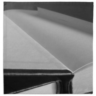 Second hand books with blank pages on a table napkin