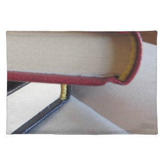 Second hand books with blank pages on a table placemat