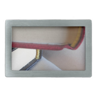 Second hand books with blank pages on a table rectangular belt buckles