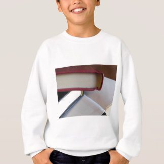 Second hand books with blank pages on a table sweatshirt