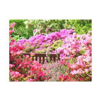 Secret bench deep in a pink flower garden canvas print