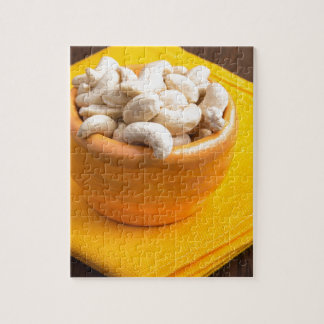 Selective focus on raw cashew nuts closeup puzzle